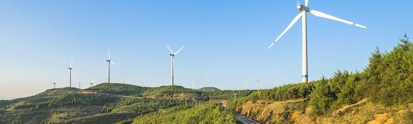 wind turbines along rocky road