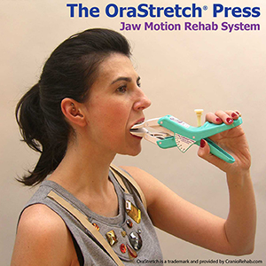 Woman using OraStretch press