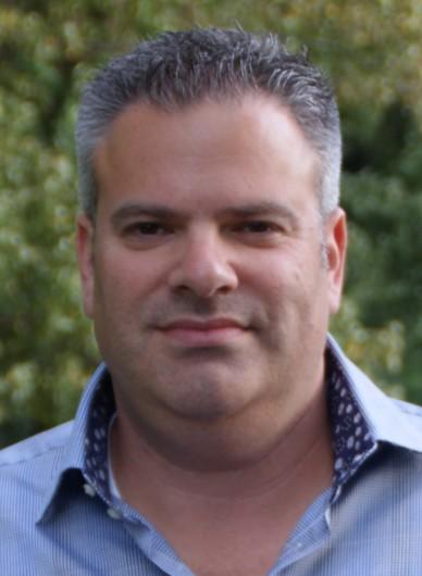 Man wearing blue button shirt