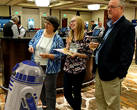 R2D2, Shelly Saunders and Jacqueline LaLiberte from Graco and DCL's Brian Trombley at the CMS DITA NA at Casino Night.